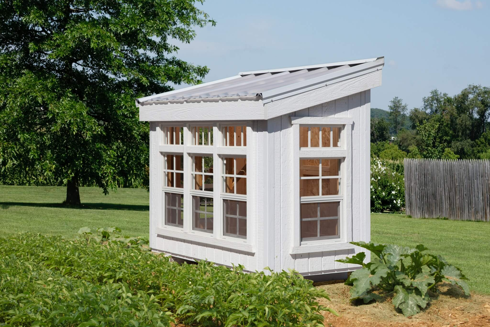 The perfect mini greenhouse for small projects, the Petite Greenhouse features five 14x21 windows, five 6x14 transom windows. Designed exclusively by Little Cottage Company®.